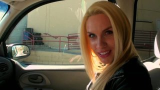 Fair-haired devil Jewels Devine gives a solid blowjob right in the car